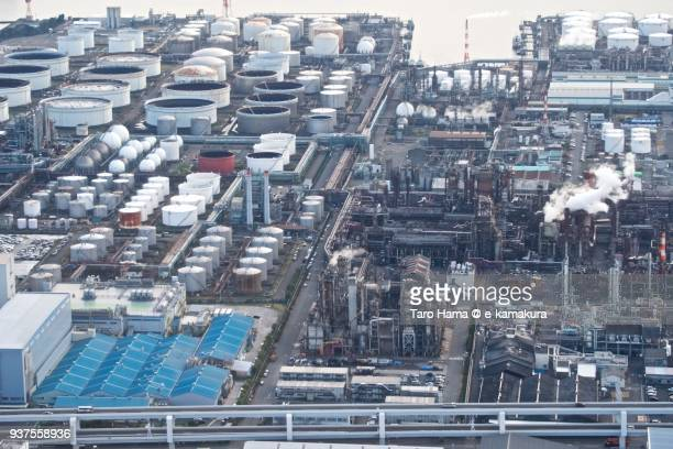 oil stockpile bases and chimneys factory area in kawasaki city in kanagawa prefecture in japan daytime aerial view from airplane - 川崎市 ストックフォトと画像