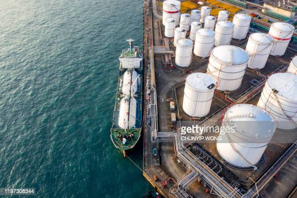 oil storage tank in the port in tsing yi, hong kong - drone stock pictures, royalty-free photos & images