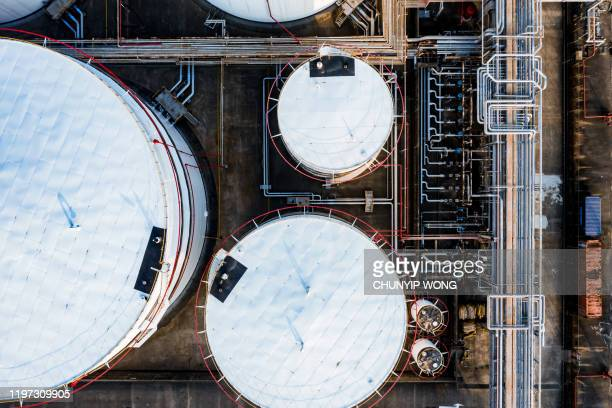 oil storage tank in the port in tsing yi, hong kong - storage tank stock pictures, royalty-free photos & images