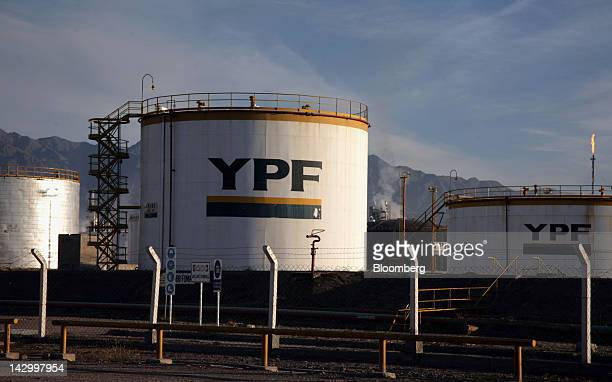 Oil storage tanks at the Lujan de Cuyo Repsol YPF SA oil refinery are seen at the foot of the Andes mountain range close to the Chilean border in the...