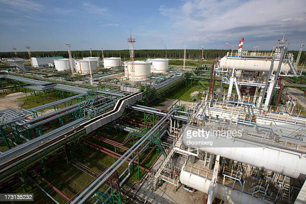 Oil storage tanks stand amongst pipework at an oil plant operated by Salym Petroleum in Salym KhantyMansi autonomous region Russia on Wednesday July...