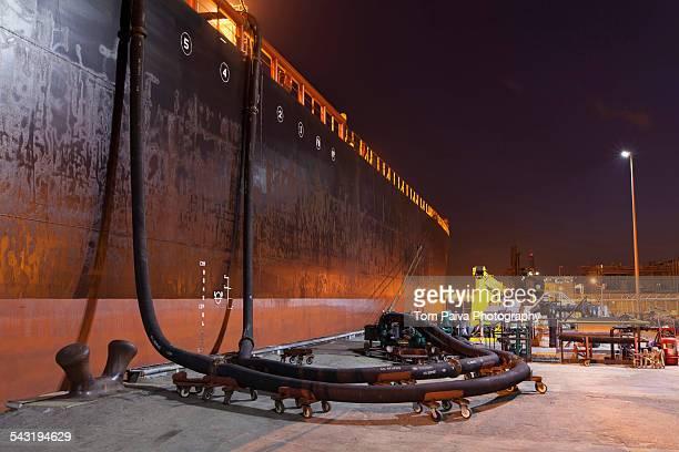 Oil tanker ship docked in industrial harbor
