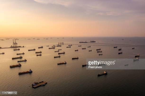 oil tanker ship loading in port at twilight, aerial view from above - 液化天然ガス ストックフォトと画像