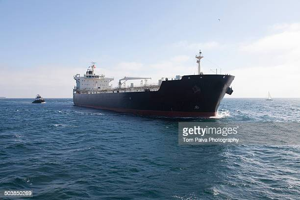 oil tanker with tugboat at sea - ship stock pictures, royalty-free photos & images