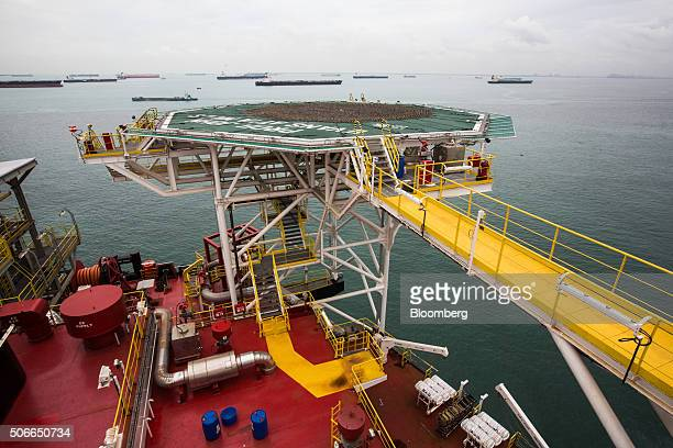 Oil tankers are seen beyond the helideck of the Tullow Oil Plc Prof John Evans Atta Mills Floating Production Storage and Offloading vessel docked at...