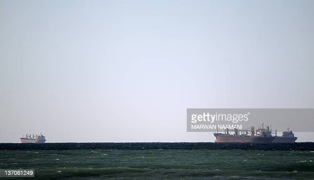 Oil tankers cruise out the Strait of Hormuz off the shores of Tibat in Oman on January 15, 2011. Iran threatened to close the Strait of Hormuz in the...