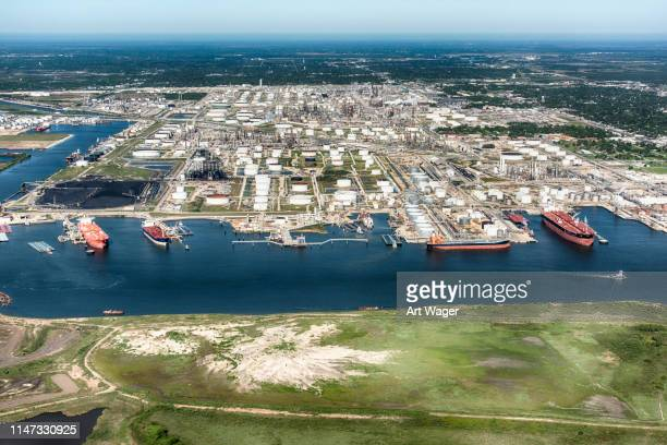 oil tankers docked at an american refinery - houston stock pictures, royalty-free photos & images