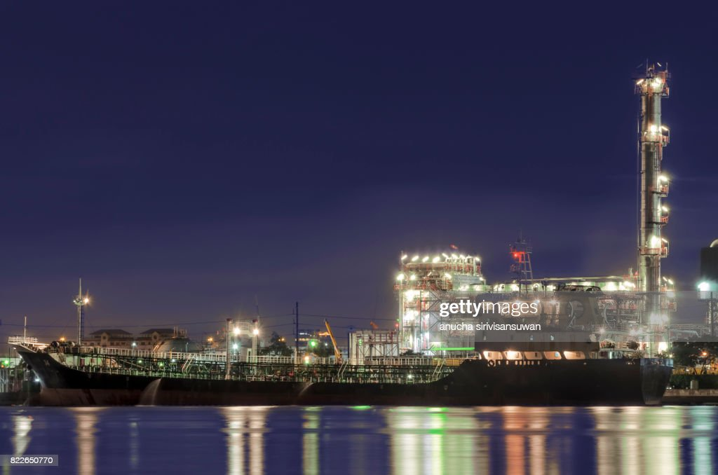 Oil tankers park at the pier oil refinery at night . : Stock Photo