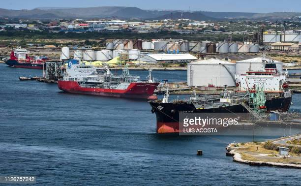 Oil tankers remain docked in front of Isla oil refinery which is leased by Venezuelan state oil company PDVSA in Willemstad Curacao Netherlands...