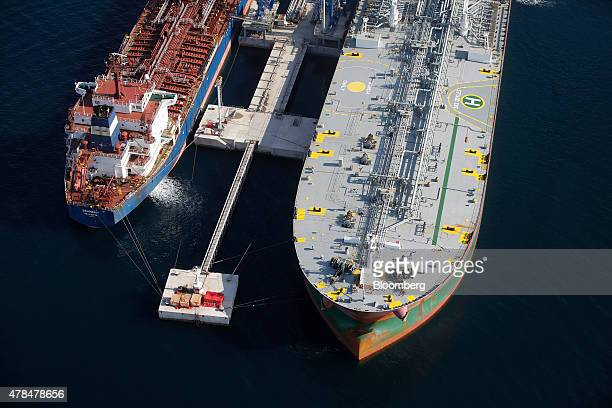 Oil tankers sit at their moorings during loading operations at the Aspropyrgos refinery operated by Motor Oil Corinth Refineries SA in Athens Greece...