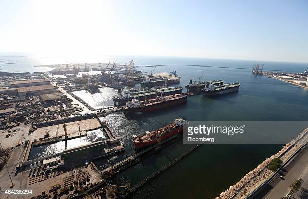 Oil tankers sit in the commercial harbor during shipping operations at Port Rashid in Dubai United Arab Emirates on Tuesday Nov 11 2014 Declining...