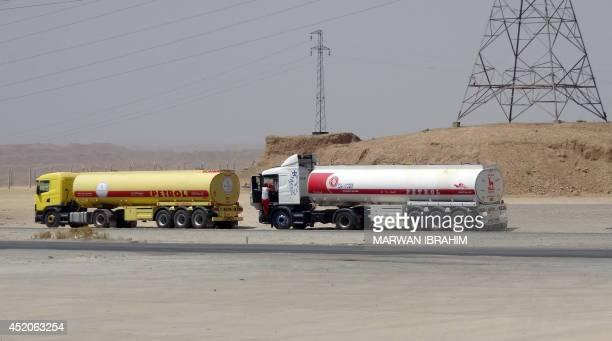 Oil tankers transport petrol sold by IS to Kurdish business men on July 12 in Iraq's disputed northern city of Kirkuk Iraq's Kurdish region claimed...