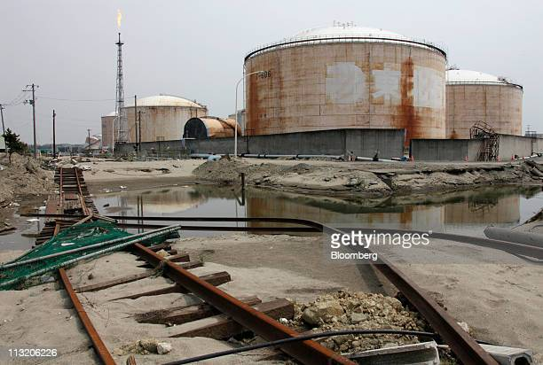 Oil tanks damaged in the March 11 earthquake and tsunami are seen at a refinery in Tagajo city Miyagi prefecture Japan on Wednesday April 27 2011...