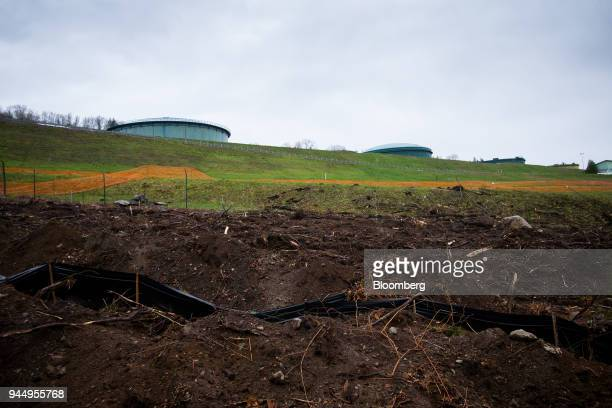 Oil tanks stand near the Kinder Morgan Inc Trans Mountain pipeline expansion site in Burnaby British Columbia Canada on Wednesday April 11 2018...