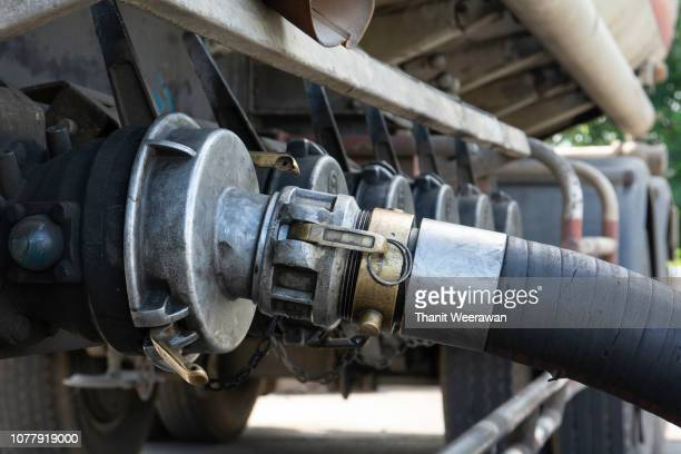 oil transfer of petroleum gasoline station service. - fossil fuel stock pictures, royalty-free photos & images