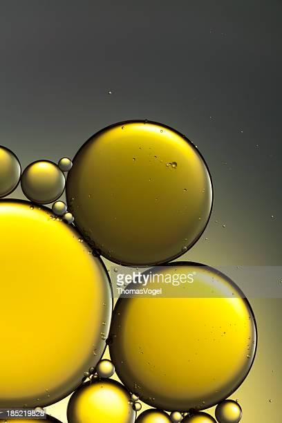 石油&ウォーター抽象的なイエローゴールドのマクロ背景
