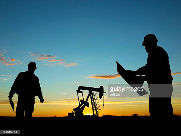 Oil Well Pump Pumpjack & Worker Silhouettes