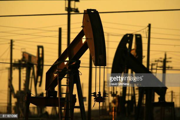 Oil wells are among the thousands pumping the oil fields of California's southern Central Valley on August 10 2004 in the town of Oildale California...