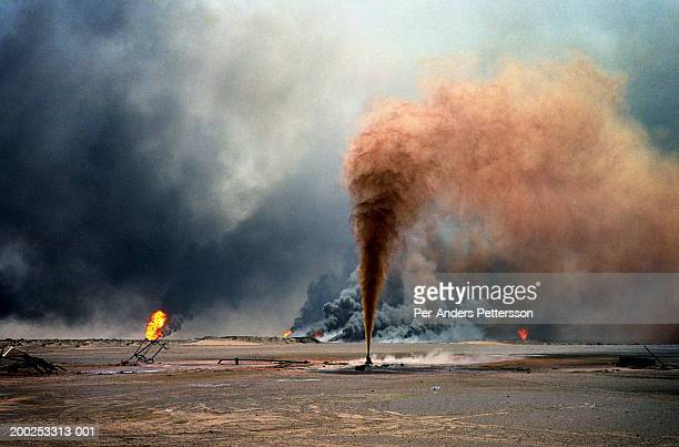 oil wells burn out of control at burham oilfield, kuwait - war stock pictures, royalty-free photos & images