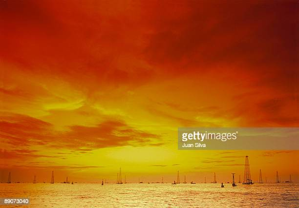 Oil Wells Offshore at Sunset