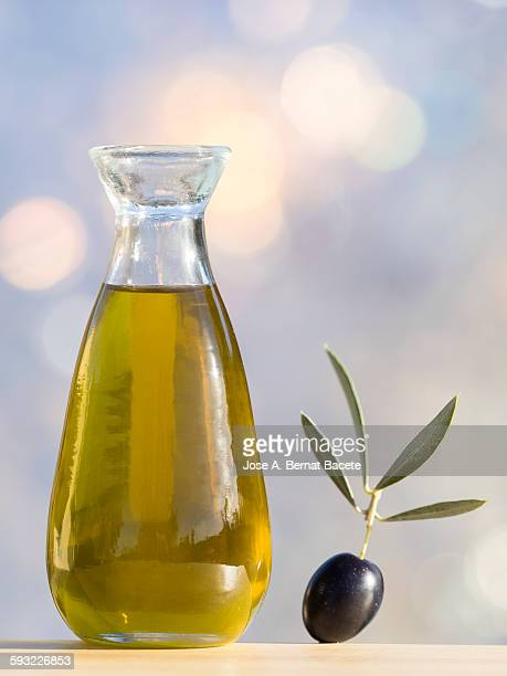 oil with extra virgin olive oil and black olives - cruet stock photos and pictures