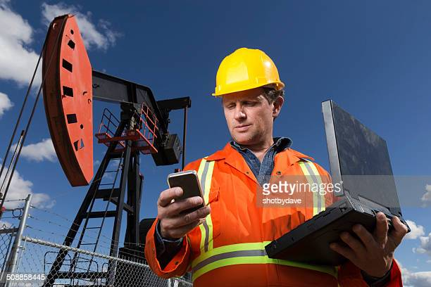 Oil Worker and Laptop