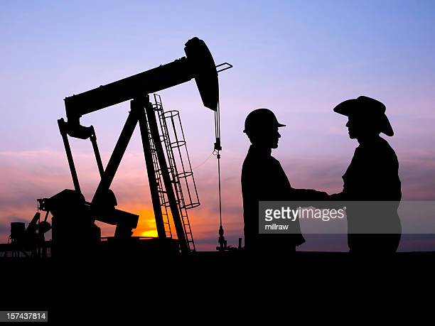 Oil Worker and Rancher Farmer Cooperating at Pumpjack