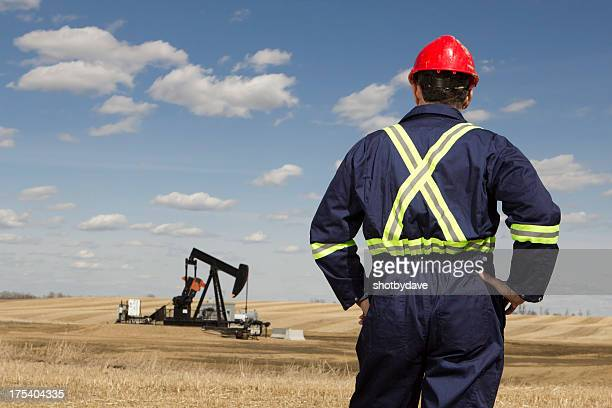 Oil Worker in a Field