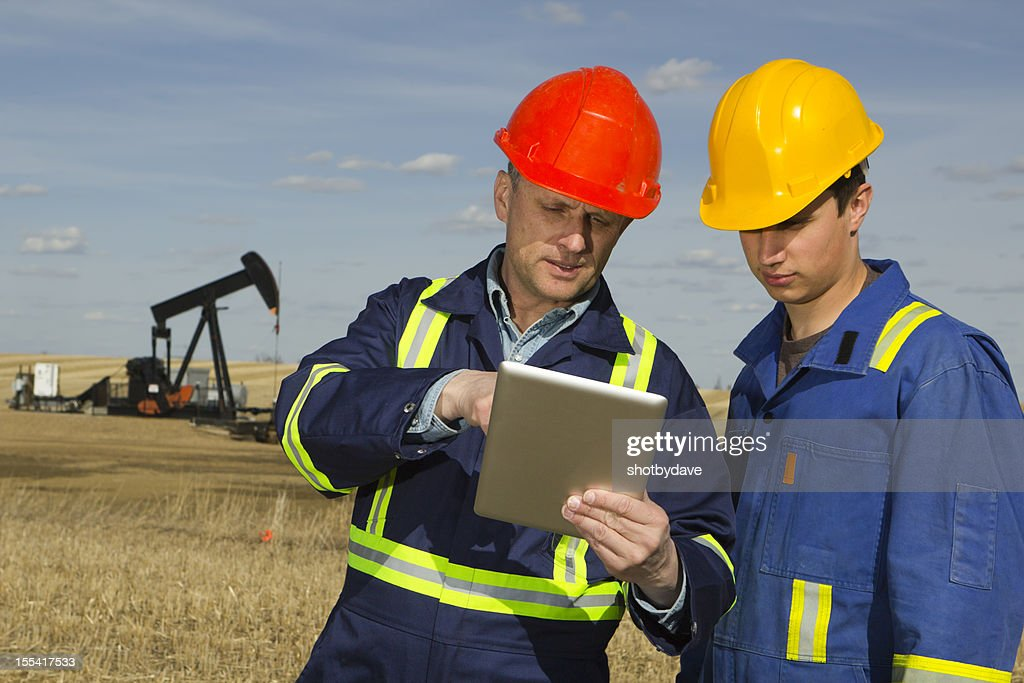 Oil Workers and Tablet PC : Stock Photo