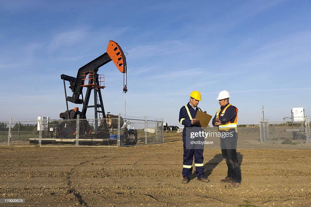 Oil Workers in Conversation : Stock Photo