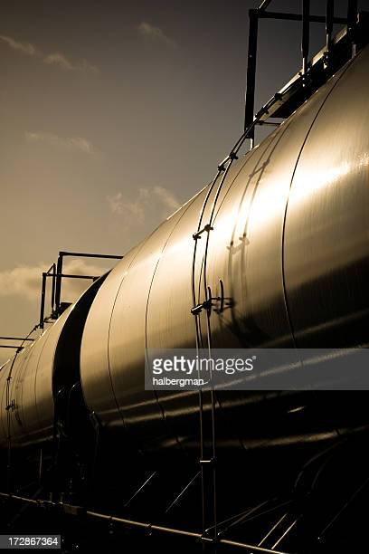 oil-carrying freight train at sunset - gas refinery stock photos and pictures