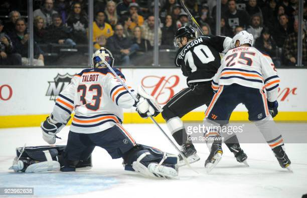 Oilers defenseman Darnell Nurse and Kings forward Tanner Pearson battle for position in front of Oilers goaltender Cam Talbot during the first period...