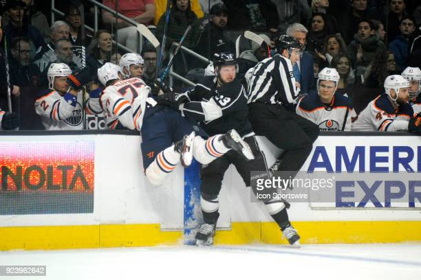 Oilers defenseman Oscar Klefbom is checked hard into the boards by Kings defenseman Kyle Clifford during the first period of their game on February...