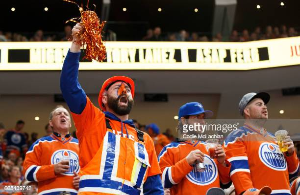 Oilers fans yell at the officials as the Edmonton Oilers take on the San Jose Sharks in Game One of the Western Conference First Round during the...