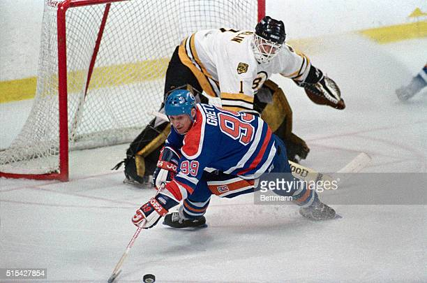 Oiler's Wayne Gretzky goes after puck after it was deflected by Bruins' goalie Reggie Lemelin during the 1st period of game 3 of the Stanley Cup...
