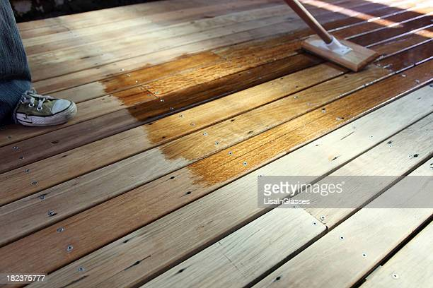 oiling the deck - deck stock pictures, royalty-free photos & images