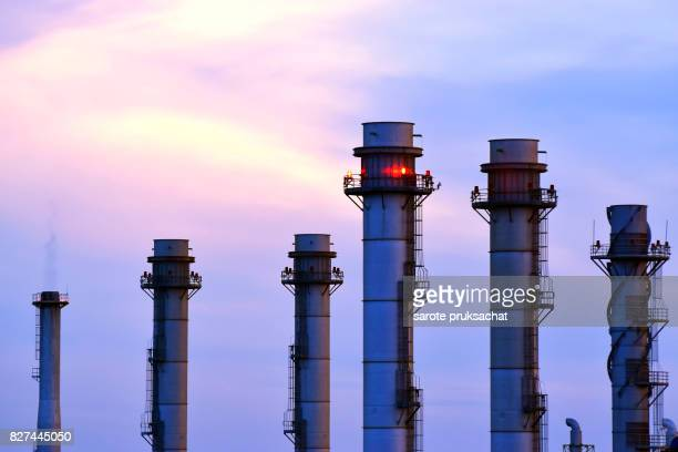 oil-refinery plant at sunset sky . - atomic imagery 個照片及圖片檔