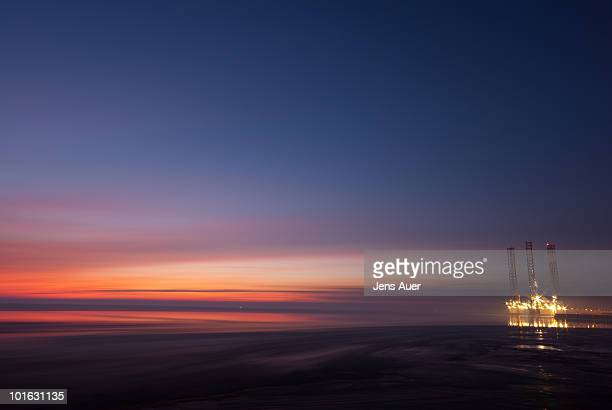 oilrig in drifting ice during sunset - denmark stock pictures, royalty-free photos & images