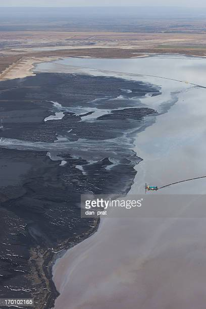 oilsands tailings pond - oil sands stock pictures, royalty-free photos & images
