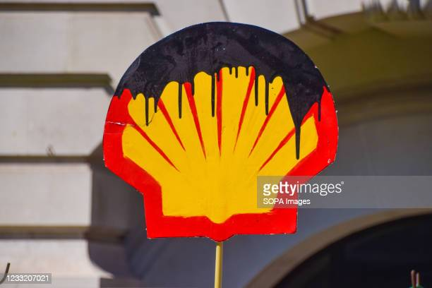 Oil-stained Shell logo seen outside the Science Museum in London during Extinction Rebellion's anti-Shell protest. The activists gathered outside the...