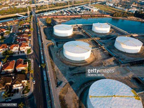 Oilstorage tanks are seen from above in Carson California April 25 2020 after the price for crude plunged into negative territory for the first time...