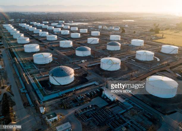 Oil-storage tanks are seen from above in Carson, California, April 25, 2020 after the price for crude plunged into negative territory for the first...