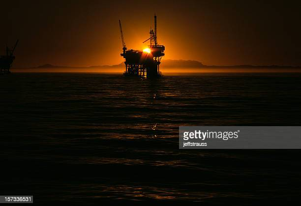 oil-well at sunset