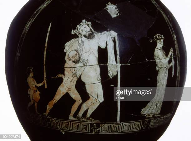 Oinochoe of red figures for the Antesteria's party It depicts Dionysos divinity of the wine drunk and sustained by a satire Attica around 430 BC...