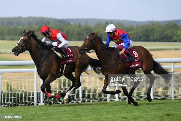 Oisin Murphy on Dierdre on their way to victory over Frankie Dettori and Mehdaayih in the Qatar Nassau Stakes at Goodwood racecourse on August 01,...