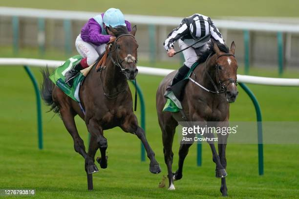 Oisin Murphy riding Alcohol Free win The Juddmonte Cheveley Park Stakes from Ryan Moore and Miss Amulet at Newmarket Racecourse on September 26, 2020...