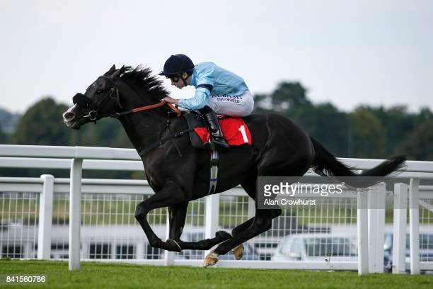 Oisin Murphy riding Archetype win The All New Fiesta At Trust Ford Handicap Stakes at Sandown Park racecourse on September 1 2017 in Esher England