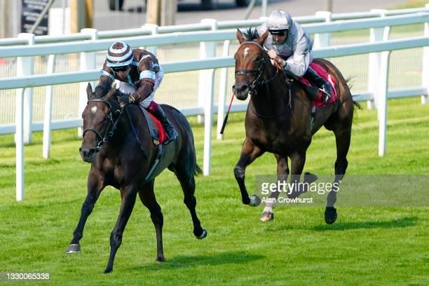 Oisin Murphy riding Arenas Del Tiempo win The Twickenham Fillies' Handicap at Sandown Park Racecourse on July 22, 2021 in Esher, England.