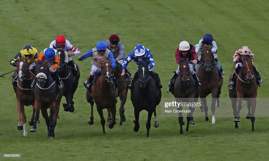 Oisin Murphy riding Desert Haze (C, blue) win The Smarter Bets With Matchbook Betting Exchange Fillies' Stakes at Goodwood on July 26, 2016 in Chichester, England.