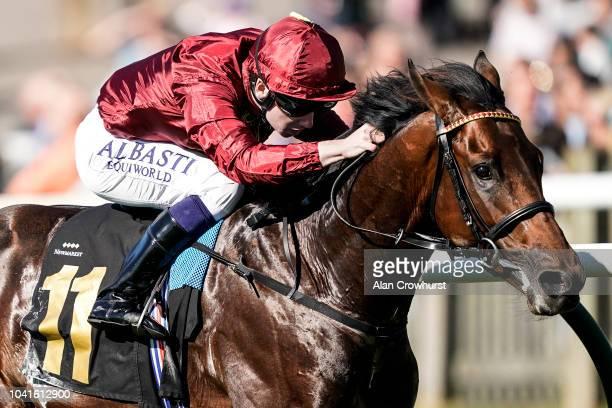 Oisin Murphy riding Kick On win The Bonhams EBF Maiden Stakes at Newmarket Racecourse on September 27 2018 in Newmarket United Kingdom